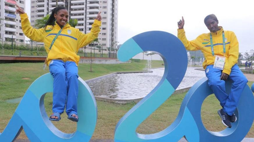 Nyirarukundo (left) and teammate Claudette Mukasakindi pose on the Rio Olympics rings. The 18-year old will compete in women's 10,000m final today. (Courtesy)
