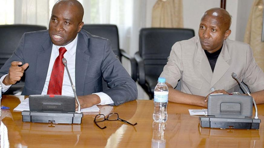 PS Mulindwa addresses the media as Internal Security minister Musa Fazil Harerimana looks on in Kigali yesterday. (Timothy Kisambira.)