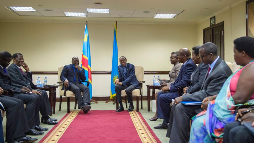 President Kagame and his Congolese counterpart Joseph Kabila during bilateral talks alongside officials from both countries in the border district of Rubavu yesterday. In a joint n....