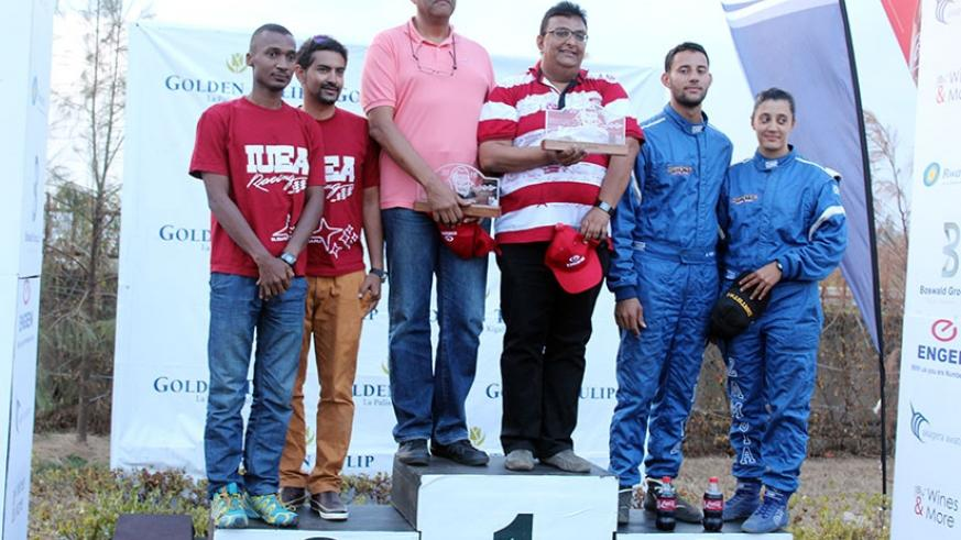 L-R: The top three in the 2016 Rwanda Mount Gorilla Rally, Hassa Alwi, Bukera and Muna Singh Jr., all pose with their navigators on the podium. / Jeje Muhinde.