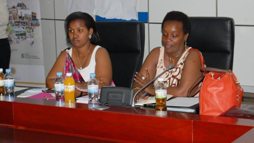 The City of Kigali vice mayor in charge of social affairs, Judith Kazayire (L), and Gender and Family Promotion minister Diane Gashumba during the General Assembly of National Wome....