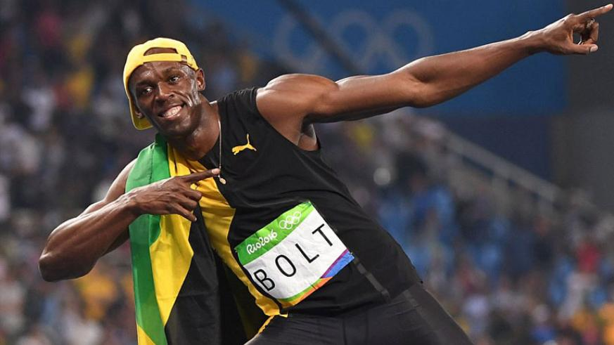Bolt creates his trademark 'lightning bolt' pose for the cameras as he celebrates yet another Olympic success. / Net photo