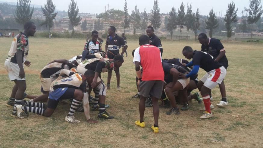 Lion de Fer (black) and Sharks get down for a scrum during the game at the Utexrwa ground on Saturday. (Stephen Kalimba)