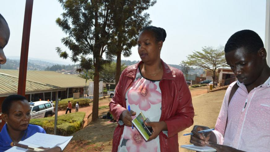 Mariam Kaberuka, Director of Mituelle Registration at RSSB explains to journalists how the new system works. (Photos by H. Kuteesa)