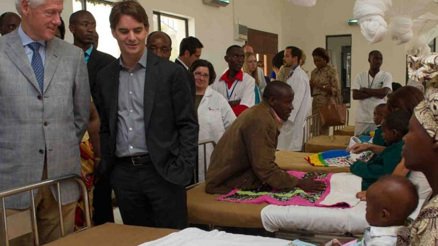 Former US President Bill Clinton (L) and other officials visit a hospital ward on a guided tour of Butaro Cancer Centre in Burera District during a previous visit to Rwanda. / File