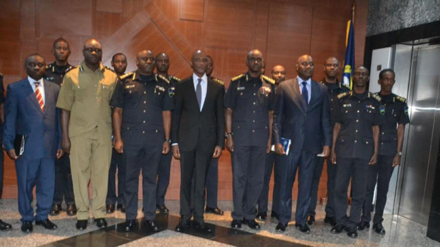Rwanda National Police and Uganda Police Force officials pose for a group photo after the meeting in Kigali yesterday. / Courtesy