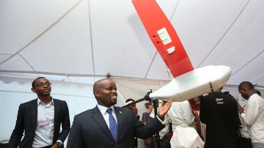 The Minister for Youth and ICT Jean-Philbert Nsengimana with one of the drone prototypes. / File.