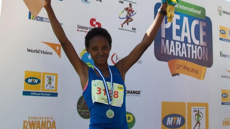 Salome Nyirarukundo celebrates after finishing second in Kigali Peace Half Marathon early this year. / File