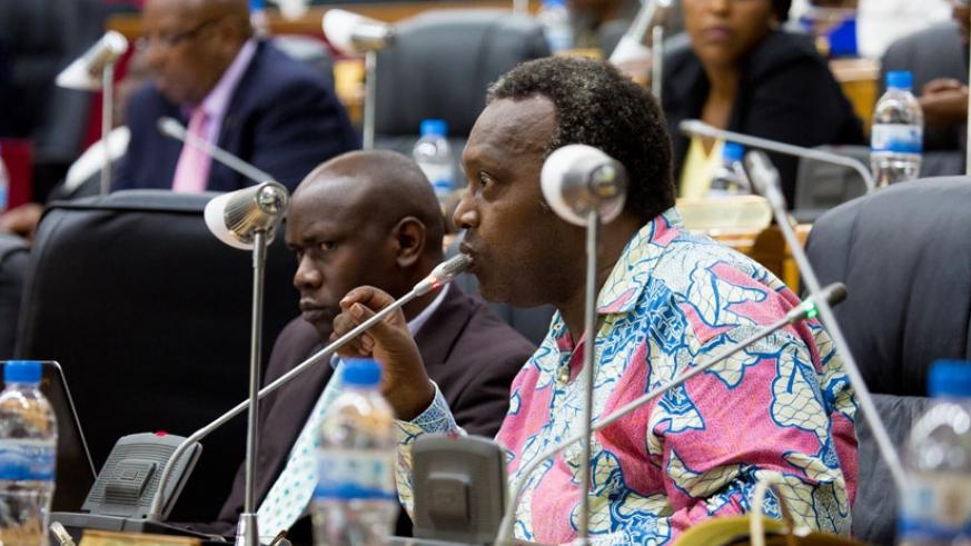 PAC chair Nkusi speaks as committee member Theodomir Niyonsenga looks on during a past session.  (File)