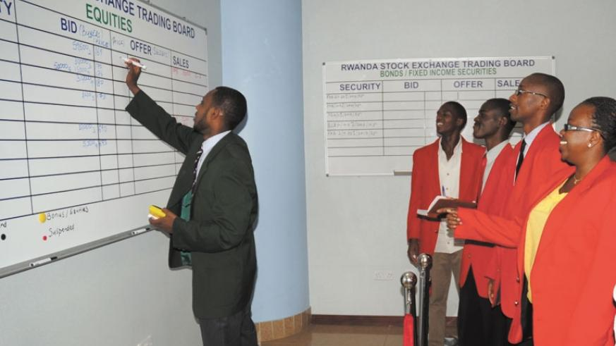 Stock brokers at the RSE trading floor. Activity has been low at the exchange this year. (File photo.)