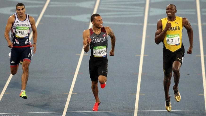 The Jamaican and his Canadian rival share a joke as they crossed the finish line, while Brit Gemili finished third (File photo)