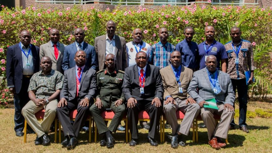 Heads of delegation and staff pose for a group photo in Kigali yesterday. / Faustin Niyigena.
