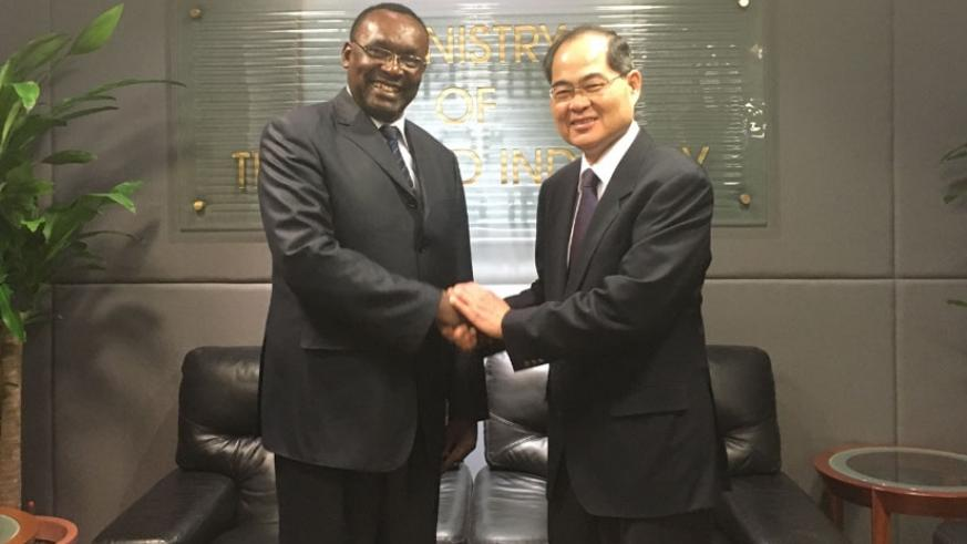Minister for Trade and Industry Francois Kanimba and his Singapore counterpart  Hon Lim Hng Kiang. / Courtesy.