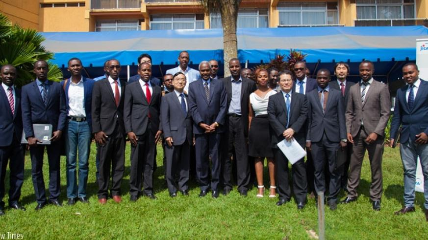 Some of the beneficiaries pose for a picture with Amb Miyashita and other embassy officials after they received their Japan student visas last week. (Nadage Imbabazi)