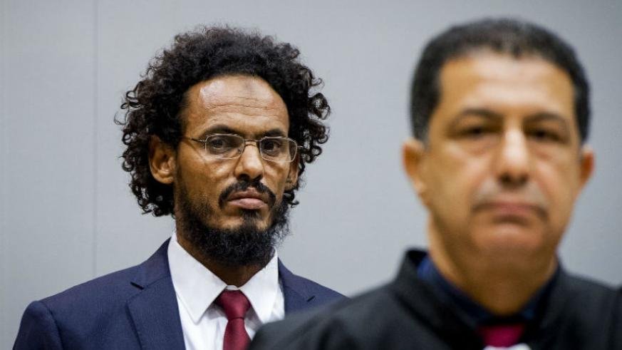 Ahmad al-Mahdi, left, appears at an earlier hearing at the international criminal court in The Hague. 