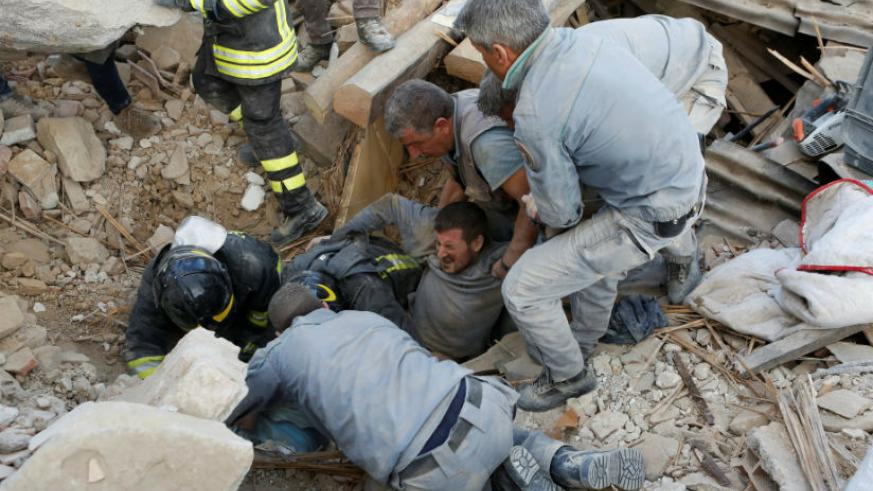 A man is rescued alive from the ruins. Photograph: Remo Casilli/Reuters