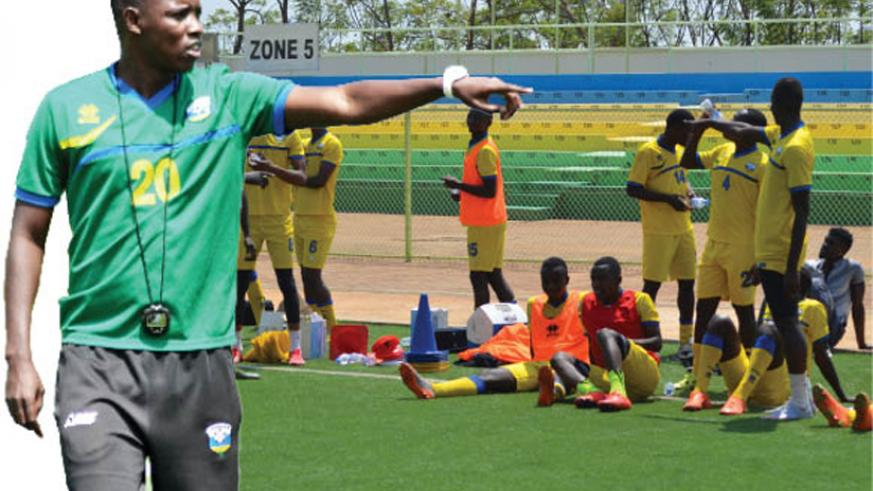 Jimmy Mulisa takes the Amavubi players through their paces at the Kigali Regional Stadium yesterday as the national team prepare for a 2017 AfCON qualifier against Ghana on Sept. 3....