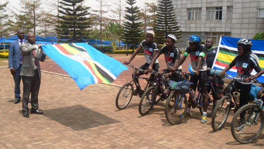 The PS in the Ministry for East African Community Affairs Innocent Safari flags off the cyclists at the ministry headquarters in Kimihurura, yesterday. / Jejje Muhinde.