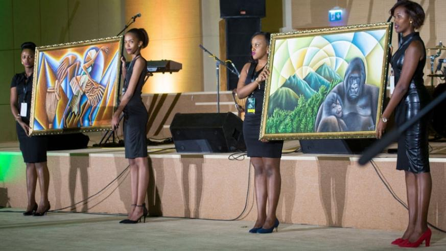 Two paintings of gorillas by artist Pascal Bushaija were auctioned at $1200 at the Kwita Izina 2016 gala dinner at Kigali Convention Center on Friday. / Faustin Niyigena.