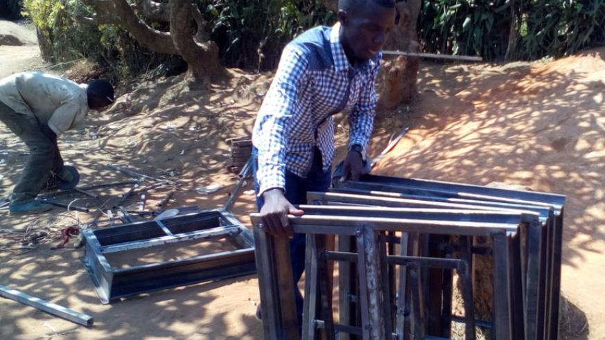 Mugera at his workshop in Kimironko. The budding entrepreneur was forced to venture into metal fabrication after failing to raise full tuition fees for university. (Lydia Atieno.)