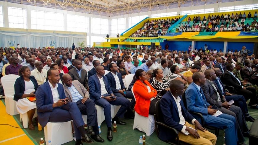 Participants at the general assembly of the City of Kigali follow the proceedings at Petit Stade in Remera. (Faustin Niyigena.)
