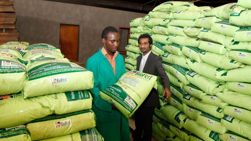 A worker carries a bag of fertilisers in one of the stores in Gikondo. / File.