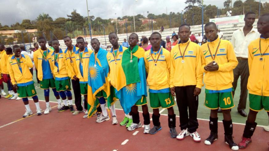 The U-18 handball team poses for a photo with their silver medals after losing to Cameroon in the final of Africa Zone 4, 5 and 6. / Courtesy.