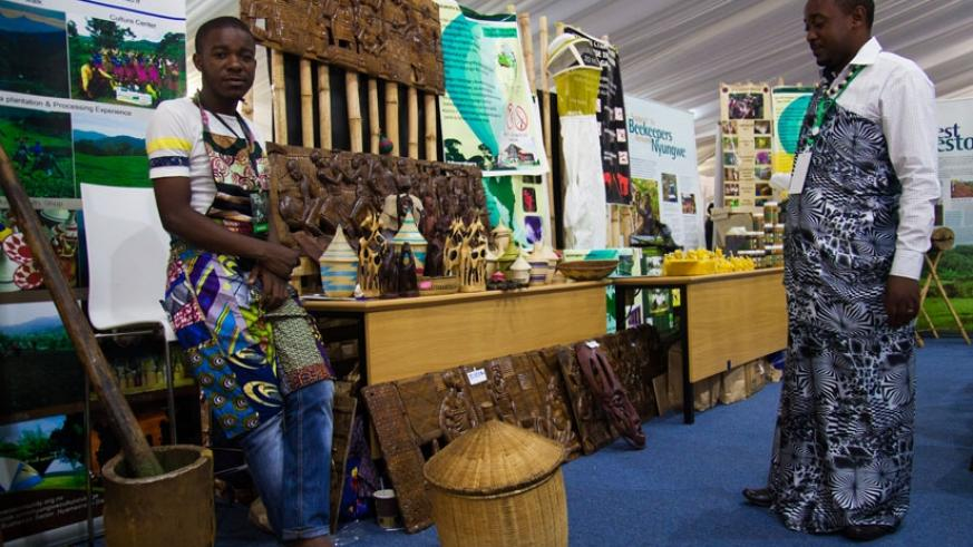 Artists from Nyungwe Cultural Village Cooperative pose for a photo in their stand during Kwita Izina exhibition in Kigali last week. (Nadege Imbabazi)