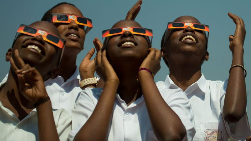 Students of St Paul International School view the major celestial event, the solar eclipse, from University of Rwanda's College of Education main campus in Kigali yesterday. (Photo....