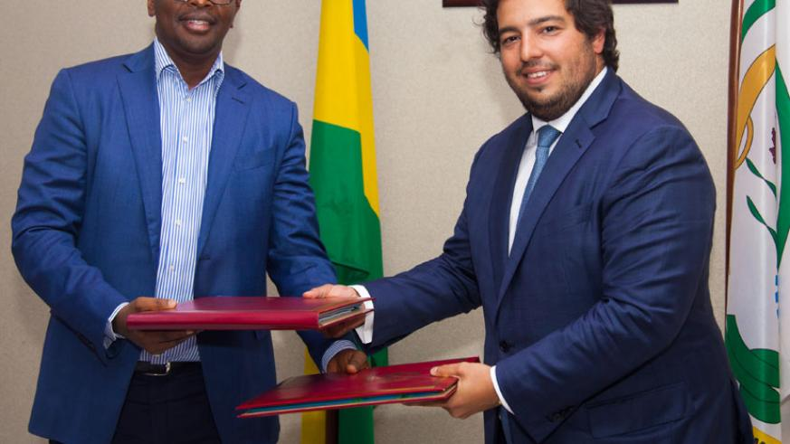 Following the Agreement signing late last night, documents were exchanged between the Minister of Infrastructure James Musoni (L)  and Mota Engil Africa Chief Manuel Mota. (Photos ....