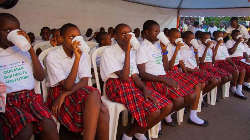 Pupils enjoy milk at the launch of the campaign to raise awareness of the importance of drinking milk in Kigali last week. Experts have called for increase of milk consumption in A....