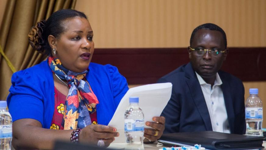 MP Nyirahabineza opens the discussion in Kigali yesterday as Ngoga looks on. (Photos by Faustin Niyigena)