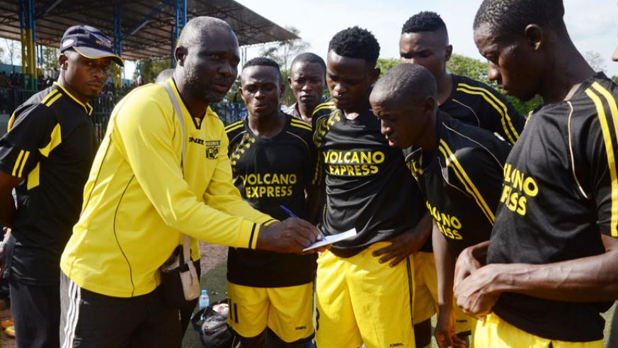 Mukura VS will miss AS Kigali pre-season tournament. Here, head coach Godfroid Okoko is seen giving instructions to his players ahead of a league match against Rayon Sports last se....