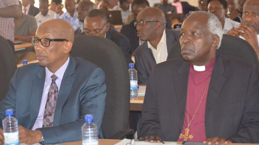 Dr. Innocent Mugisha, HEC Executive Director (left) with Bishop Onesphore Rwaje, the president of ORIPES during the meeting (Steven Muvunyi).