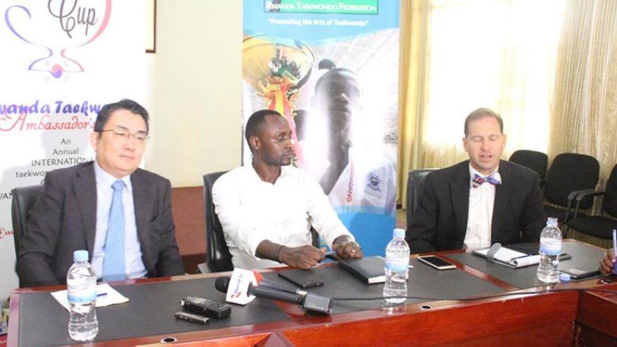 L-R: Amb Park Yong-Min, Bagabo  and technical director Martin Koonce at the press conference on Wednesday. (J. Asiimwe)