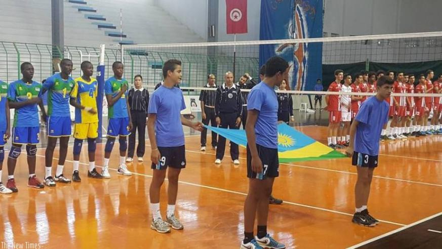 Rwandan players and their Tunisian counterparts observing the national anthems of the two countries before the game started. (Courtesy)