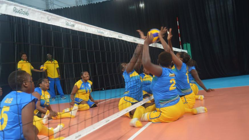 The national sitting volleyball team trains before their match against China which they lost 3-0. Rwanda plays Iran in their second group match tomorrow. / Pascal Bakomere