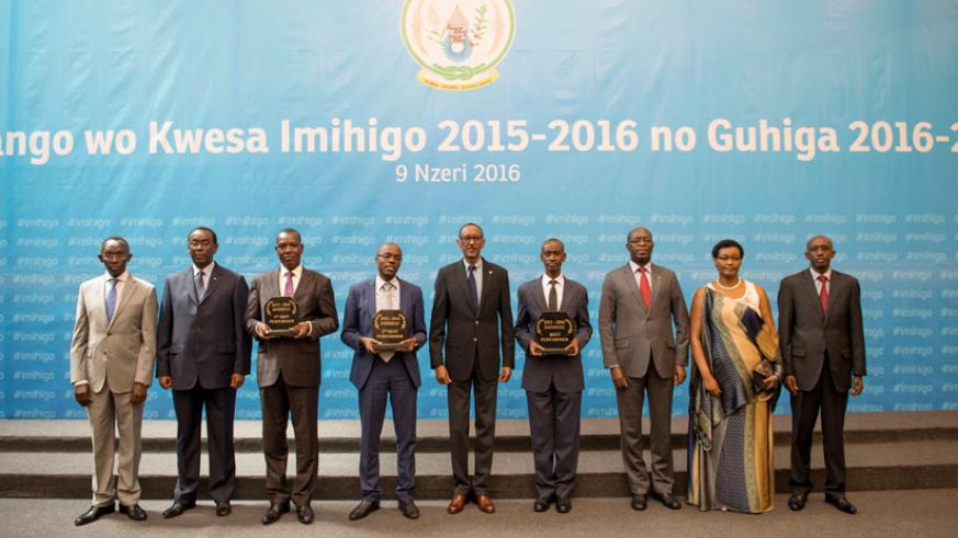 President Kagame in a group photo with local leaders whose districts shone in the Imihigo for 2015/16 and other government officials yesterday. During the meeting at Kigali Confere....