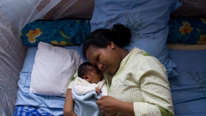 A woman with her baby sleep in a mosquito net. Experts have warned that Sub-Saharan Africa is likely to see a surge in malaria cases due to climate change. / File