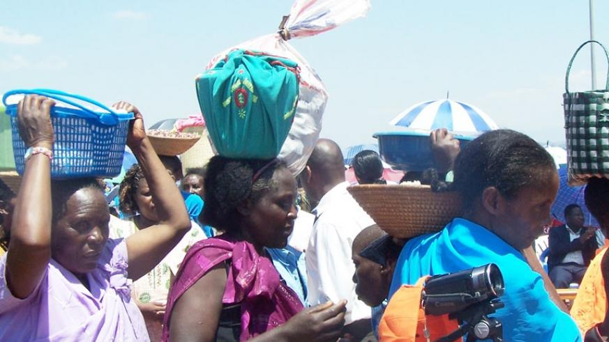 Pilgrims carry offerings at Kibeho. (File)