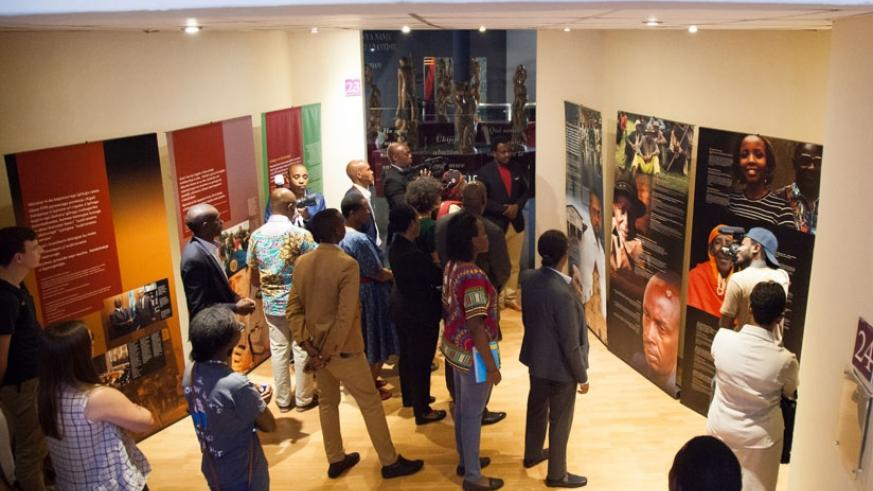Visitors read messages on the Genocide at Kigali Genocide Memorial Centre. (T. Kisambira)
