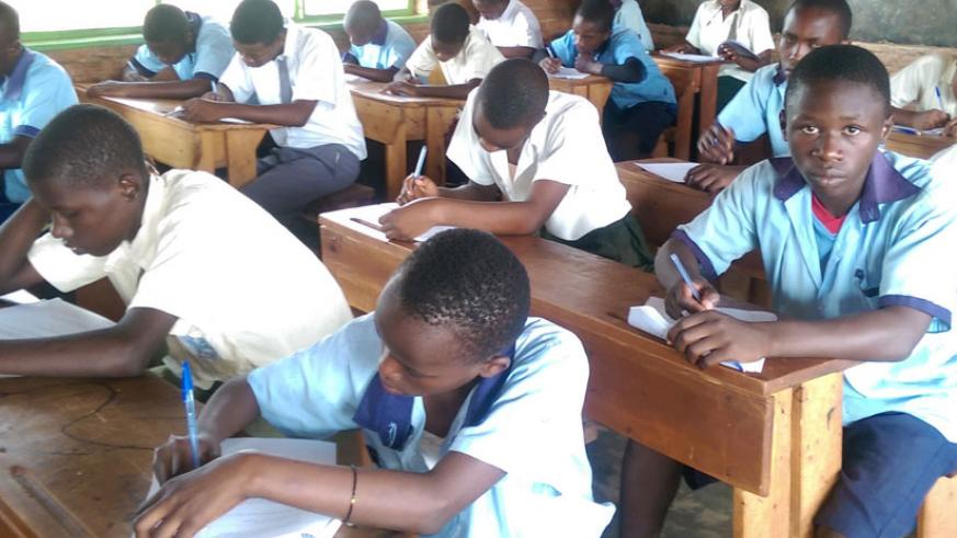 Students sit an examination. Completion rates among students require innovative ways to keep them motivated in studies. / Solomon Asaba