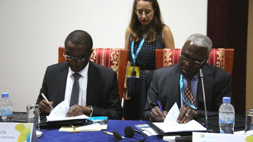 The Minister for Natural Resources, Dr Vincent Biruta (L), and Dr Josua Dione, senior advisor to the African Union Commissioner for Rural Economy and Agriculture, sign the 'Kigali ....
