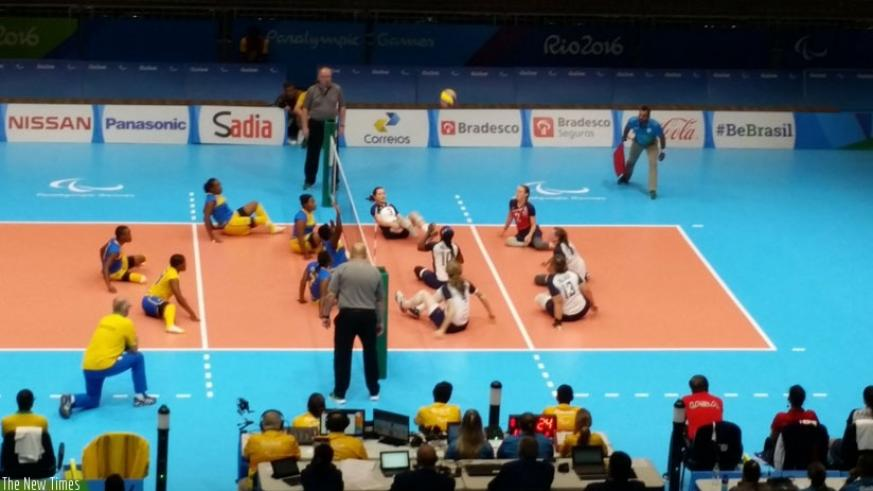 Rwanda women sitting volleyball team play against USA during their final group B game on Wednesday. (Courtesy)