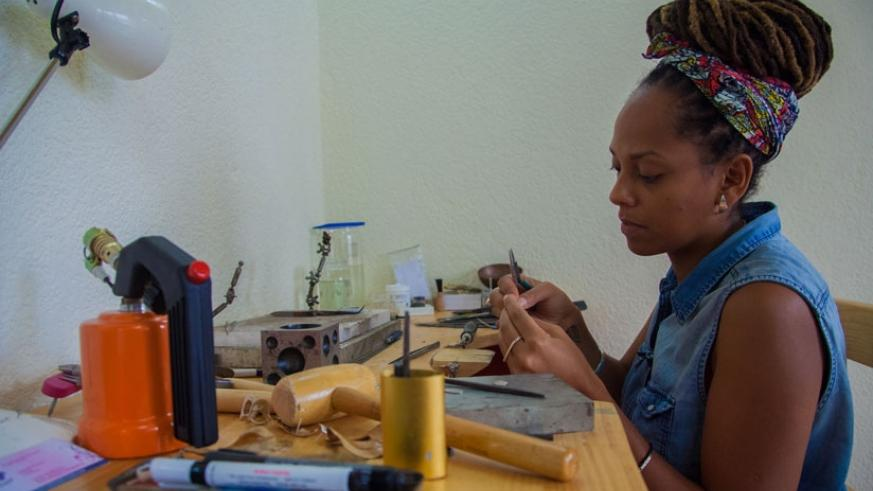 Sarafina Legrand, founder of K-Tsobe, in her jewelry workshop in Kigali. (Photos by Faustin Niyigena)
