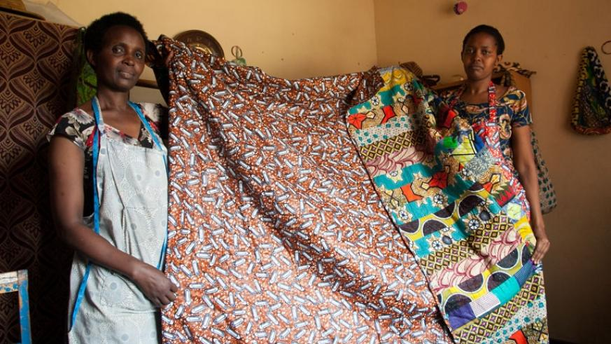 Women entrepreneurs display duvets they made using African print (Kitenge) at Cocoki Design Sewing. (Faustin Niyigena)