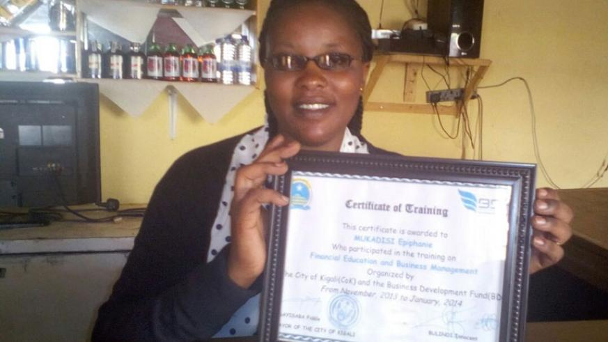 Mukadisi poses with a certificate issued after a workshop by BDF. / Elias Hakizimana.