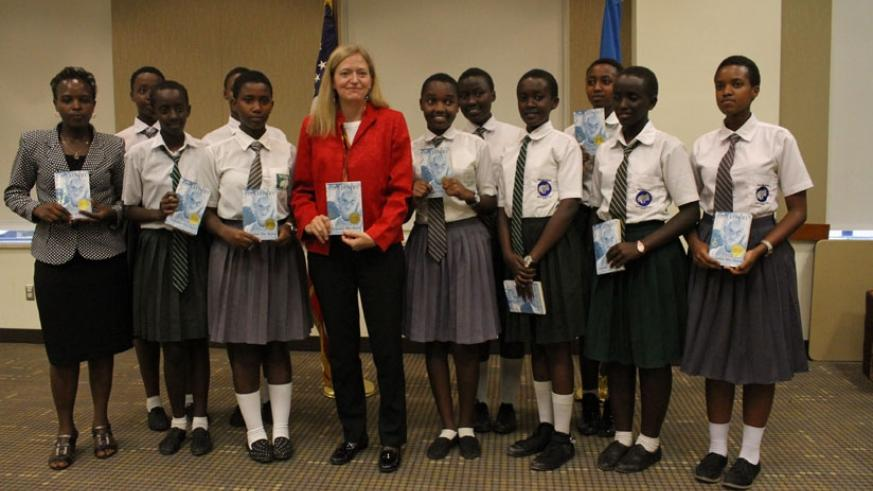 Amb. Barks-Ruggles poses with students at the launch of Everybody Reads Rwanda campaign.  / Courtesy.