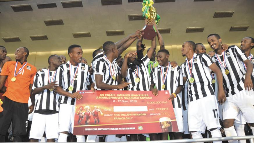 APR FC players celebrate after beating AS Vita Club in the final to win the AS Kigali Pre-season Tournament on Saturday at Amahoro National Stadium. / Sam Ngendahimana