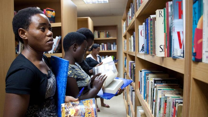 Students search for books to read at Kigali Public Library. (Timothy Kisambira)